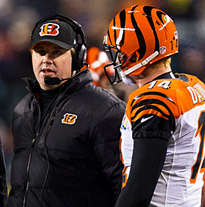 Jay Gruden, here talking with QB Andy Dalton, just finished his second season with the Bengals.