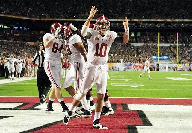 Alabama claimed its third national championship in four years in style, routing Notre Dame 42-14. The Crimson Tide jumped out to a huge lead, reaching the end zone on each of its first three drives. After a 28-0 halftime score, Alabama added two more touchdowns in the second half en route to the largest margin of victory in a BCS title game since USC's 55-19 thrashing of Oklahoma in 2005. Quarterback AJ McCarron tossed four touchdowns while running backs Eddie Lacy and T.J. Yeldon each topped 100 yards on the ground.