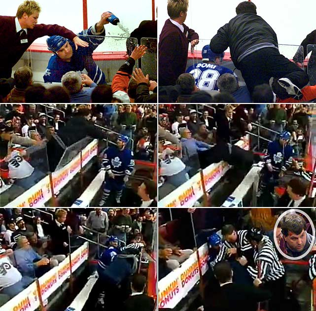 Not content to fight with players, Leafs forward Tie Domi squirts a fan with a water bottle while sitting in the penalty box during a game in Philadelphia in 2001. The fan then falls over the glass, lands next to Domi and gets pounded by the Toronto forward in the penalty box.