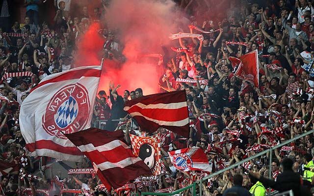 Bayern Munich fans set off flares causing smoke plumes during a game at Fortuna Duesseldorf on Oct. 20.