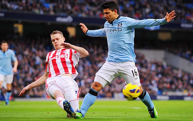 Sergio Aguero is challenged by Stoke's Ryan Shawcross in a Premier League match on Jan. 1