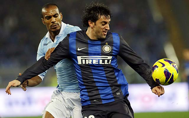 Diego Milito shields Lazio's Abdoulay Konko from the ball in a December Serie A match.