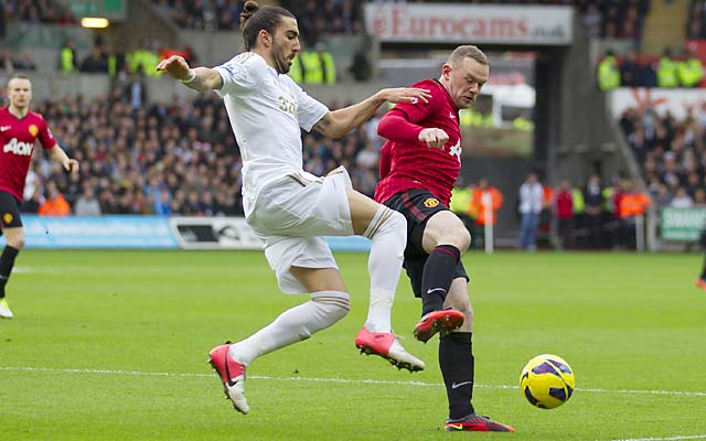 Wayne Rooney (right) battles Swansea's Chico in a Premier League match in December.