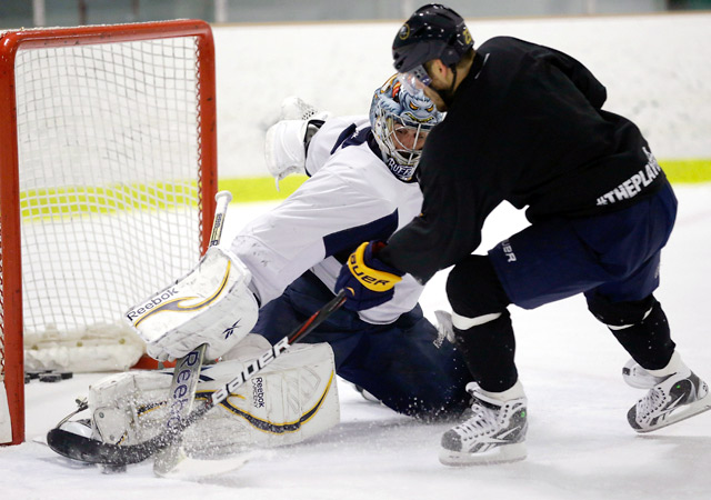 Sabres goaltender Ryan Miller makes a save on a shot by Ville leino during an informal workout.