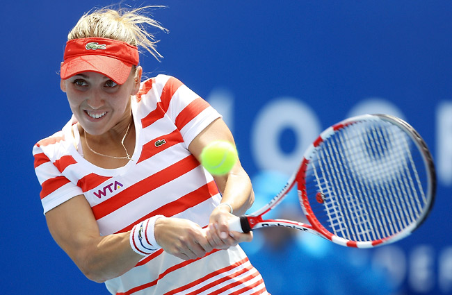 Elena Vesnina ended Mona Barthel's 12-match winning streak in Hobart to claim her first WTA title.