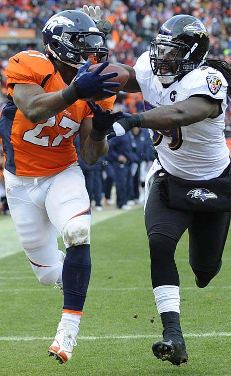Denver Broncos running back Knowshon Moreno makes a touchdown reception against Baltimore inside linebacker Dannell Ellerbe.