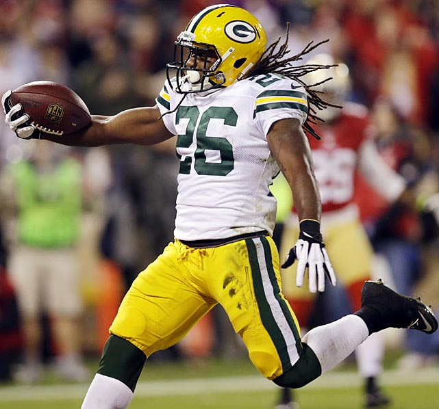 Green Bay running back DuJuan Harris scores on an 18-yard run against the 49ers. Harris led the Packers with just 53 yards rushing.