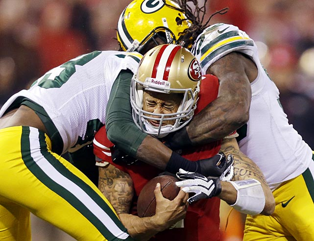 Colin Kaepernick is tackled by Green Bay free safety M.D. Jennings and outside linebacker Erik Walden.