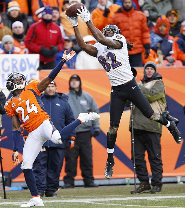 Torrey Smith adjusted his pattern in time to catch this pass for a 32-yard touchdown against Champ Bailey that tied the game at 21-21.