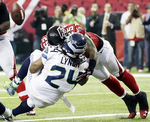 William Moore forces a Marshawn Lynch fumble, but after the ball had crossed the goal line for a touchdown to give Seattle a 28-27 lead.