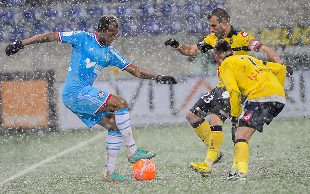 Marseille's Jordan Ayew (left) struggled to get past Mother Nature as well as Sochaux.