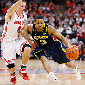 Trey Burke (3) battled with Ohio State's Aaron Craft (left) all day in Columbus.