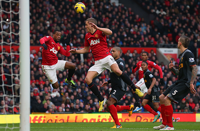 Nemanja Vidic scores Manchester United's second goal from a deflected Patrice Evra header.