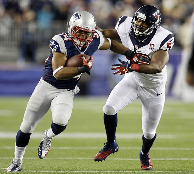 Shane Vereen evades a tackle by Houston linebacker Bradie James on a night in which the running back scored three touchdowns, two via passes.