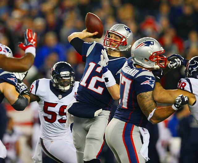 With defenders closing in on all sides, Patriots quarterback Tom Brady heaves a pass in the Patriots-Texans playoff game. Brady threw for 344 yards and three touchdowns to lead New England back to the AFC Championship, which the Patriots won last season.
