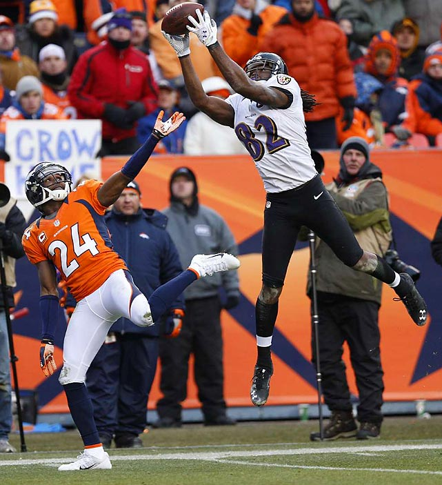 The Baltimore Ravens' Torrey Smith makes a leaping catch over Denver Broncos cornerback Champ Bailey in the AFC Divisional playoffs. Smith would take the catch into the end zone, one of two scores in the game for the 23-year-old wide receiver.