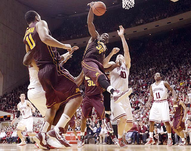Minnesota forward Trevor Mbakwe secures a rebound with one hand in the Golden Gophers' matchup with the Hoosiers in Indiana. Mbakwe's 13 points and 10 rebounds weren't enough to spark Minnesota to an upset victory.