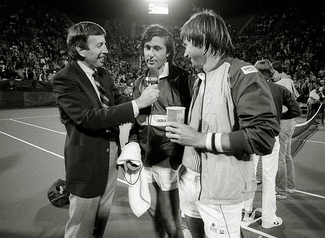 Musburger talks with Ilie Nastase and Jimmy Connors at the 1982 U.S. Tennis Tournament in Flushing Meadows, N.Y.