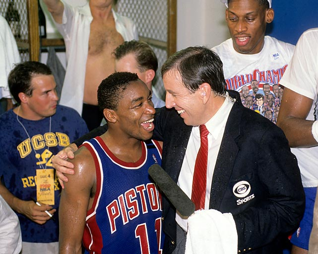 Isiah Thomas smiles as he talks with Musburger following the Detroit Pistons' Game 4 win over the Los Angeles Lakers to finish off a sweep in the 1989 NBA Finals.