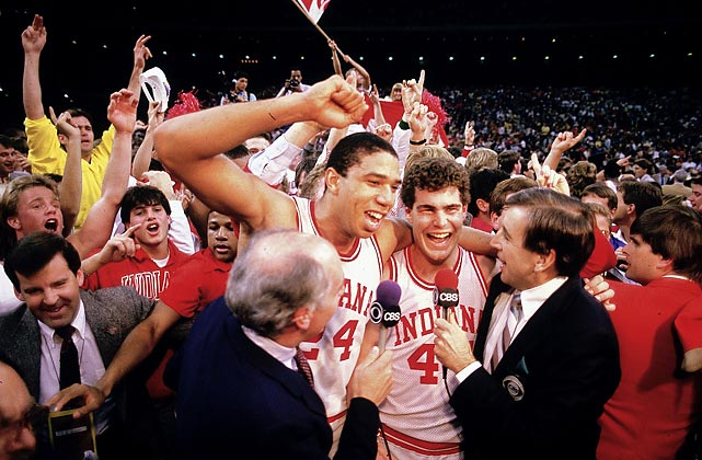 Musburger talks with the victorious Indiana Hoosiers after Indiana defeated Syracuse 74-73 to win the 1987 NCAA men's basketball championship.
