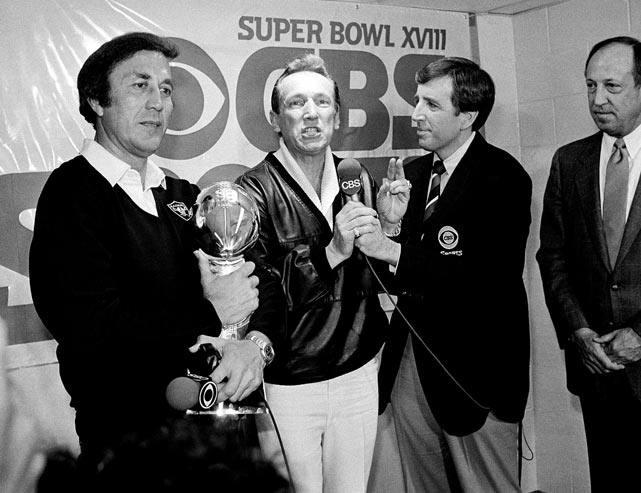 Musburger interviews Oakland Raiders managing general partner Al Davis after the Raiders' 38-9 win over the Washington Redskins in Super Bowl XVIII.