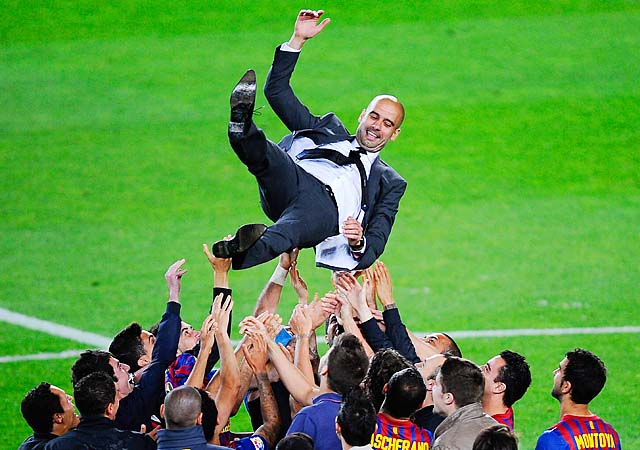 Pep Guardiola is thrown into the air by Barcelona players after his last match in May.