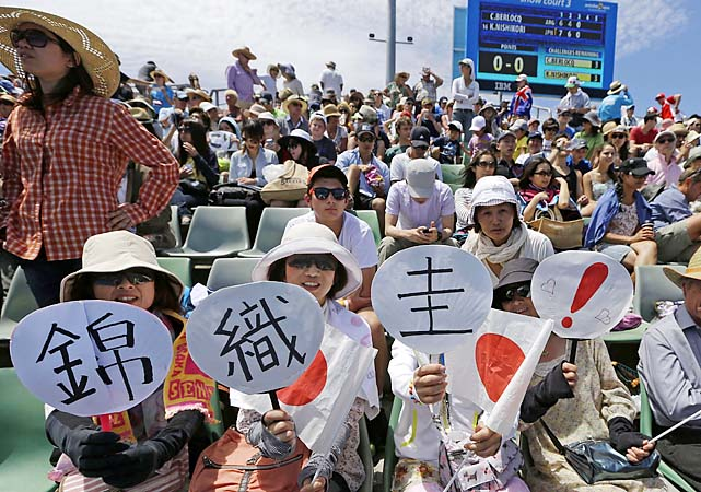 Japanese fans cheer on No. 16 Kei Nishikori, who beat Carlos Berlocq 7-6(4), 6-4, 6-1.