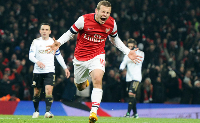 Arsenal's Jack Wilshere celebrates after scoring the winning goal in the 86th-minute against Swansea.
