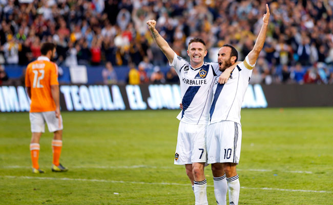 Robbie Keane celebrates with teammate Landon Donovan after winning the 2012 MLS Cup.