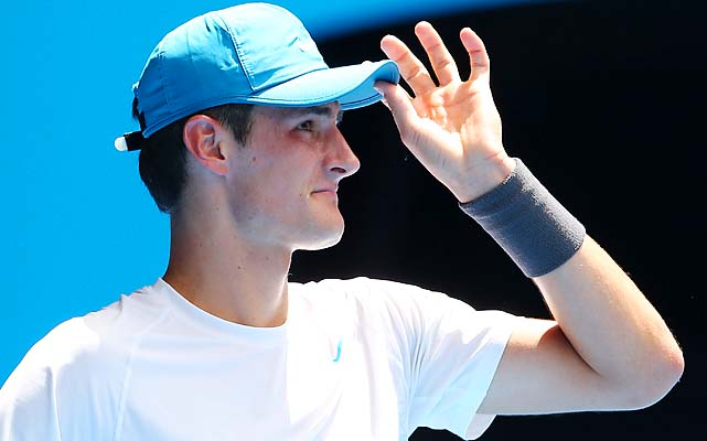 Australian Bernard Tomic beat Daniel Brands 6-7 (4), 7-5, 7-6 (3), 7-6 (8) to reach the third round and a potential match with Roger Federer.