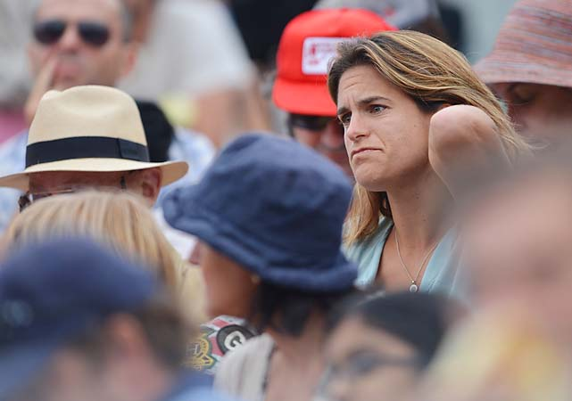 2006 Australian Open champion Amelie Mauresmo watches the action.