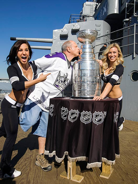 With the LA Kings gunning for another Cup, Arsee (left) and Jessica hope fan Marc Volpe isn't plantiing the kiss of death on Lord Stanley's famed punchbowl aboard the USS Iowa before the start of the 2013 NHL season.