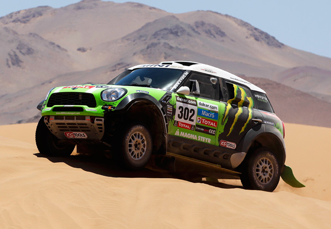 Frenchman Stephane Peterhansel maintained his overall lead after Stage 13 of the Dakar Rally.