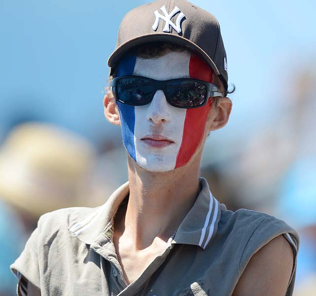 A fan with obviously confused allegiances watches France's No. 9 Richard Gasquet beat Ivan Dodig 4-6, 6-3, 7-6 (2), 6-0.