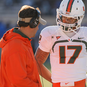 Under Jedd Fisch, shown here with quarterback Stephen Morris, Miami's pro-style offense was consistently one of the most efficient in the country.