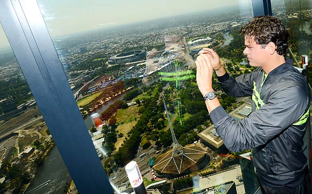 No. 13 Milos Raonic takes a photo of the view at Eureka Skytower in Melbourne.