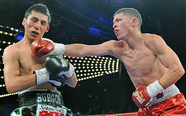Rocky Martinez (right) retained his WBO junior lightweight title after drawing Juan Carlos Burgos.