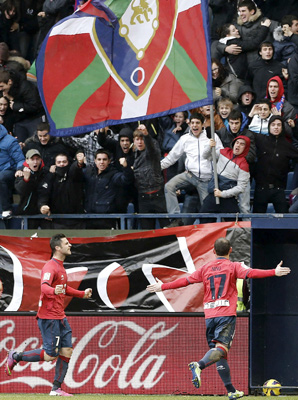 "Juan ""Nino'' Martinez (right) added the decisive goal for Osasuna in the 61st minute."