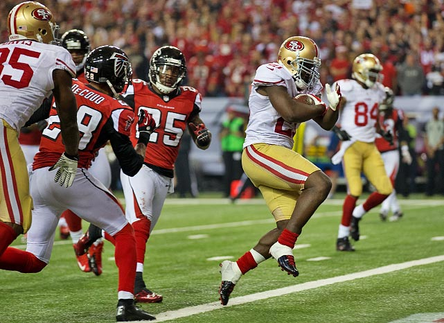 (<italics>Twenty shots from each game, starting with the NFC.</italics>) Frank Gore's second touchdown of the game, on this nine-yard run in the fourth quarter, gave the 49ers their first lead of the day and their ticket to the Super Bowl.