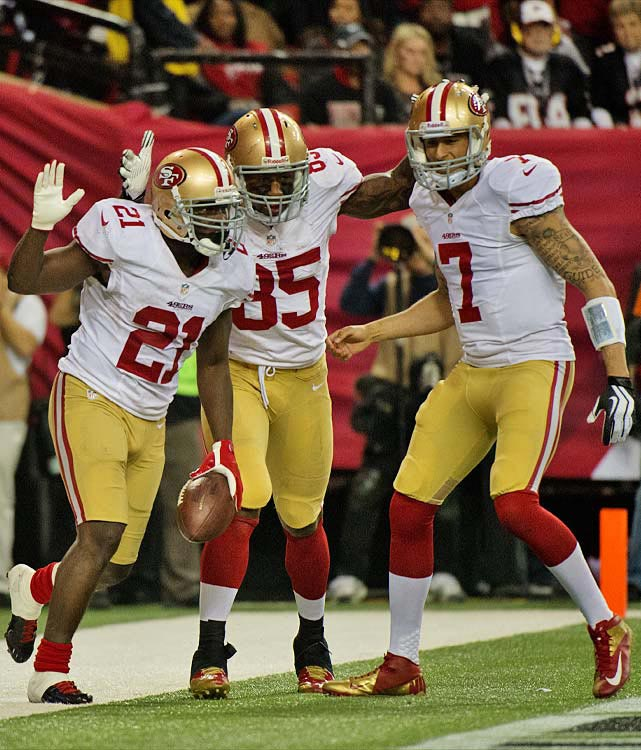 Frank Gore celebrates with Vernon Davis and Colin Kaepernick on a day in which Gore ran for 90 yards and two touchdowns.