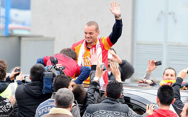Wesley Sneijder is welcomed by Galatasaray supporters after his arrival at Ataturk airport.