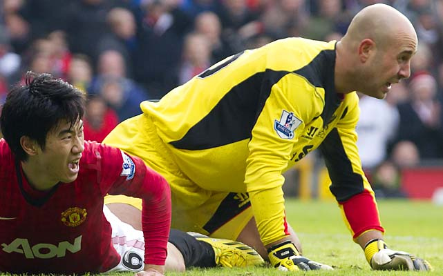 Pepe Reina (right) and Liverpool are in seventh place in the Premier League.