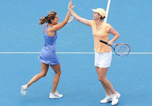 Australian Open champions Amelie Mauresmo (left) and Lindsay Davenport play legends doubles.