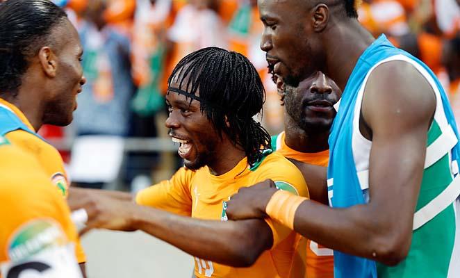 Didier Drogba (left) and Gervinho celebrate Gervinho's goal against Togo.