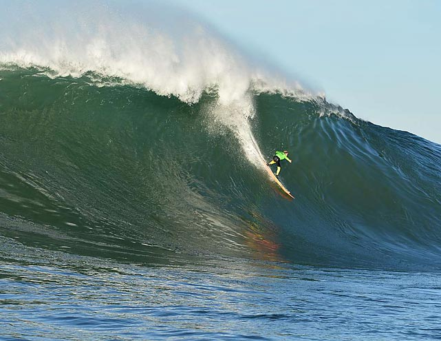 A surfer catches a big wave at the Mavericks Invitational surf contest at Half Moon Bay, Calif. Peter Mel took the win at the contest, snapping a streak of bad luck at Mavericks for the 43-year-old that dates to the event's first competition in 1999.