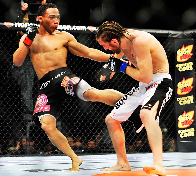 John Dodson kicks Timothy Elliott in a flyweight bout during UFC on Fox 3 at the Izod Center. Dodson won by unanimous decision in the third round.