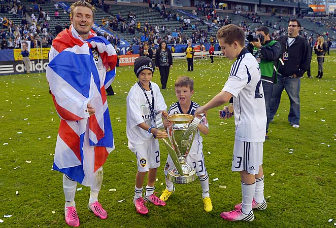 David Beckham celebrates the MLS Cup win with sons Romeo, second from left, Cruz, second from right, and Brooklyn.