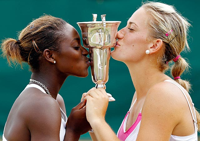 Also pictured: Championship teammate Timea Babos.