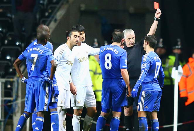Eden Hazard of Chelsea is sent off by referee Chris Foy after kicking a ball boy.