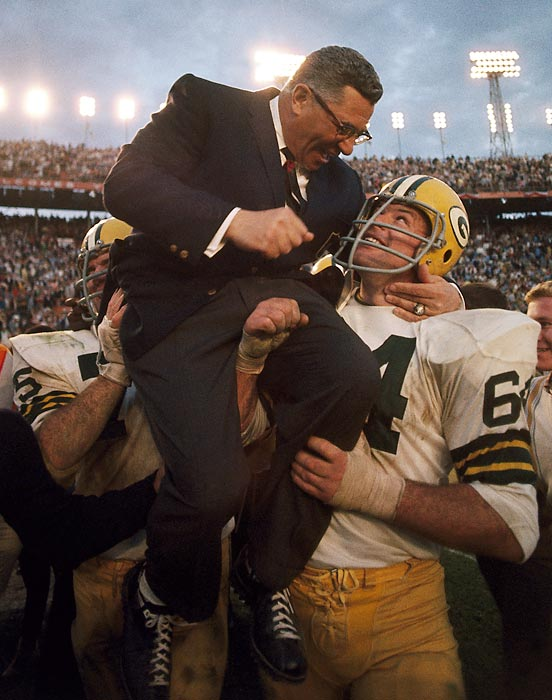 SI's photographers have shot every Super Bowl in history, leading to this collection of their best shots -- with at least one picture from every game.  Jerry Kramer and Forrest Gregg carry head coach Vince Lombardi off the field after the Packers' 33-14 win over the Oakland Raiders. The victory, Green Bay's second straight Super Bowl triumph, was Lombardi's final game as the Packers' coach.